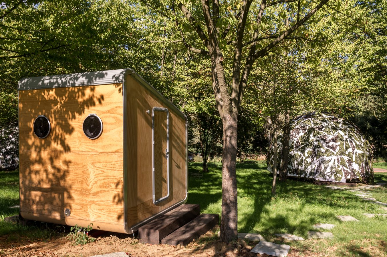 Glamping LeapNest toilet unit with camouflage tent