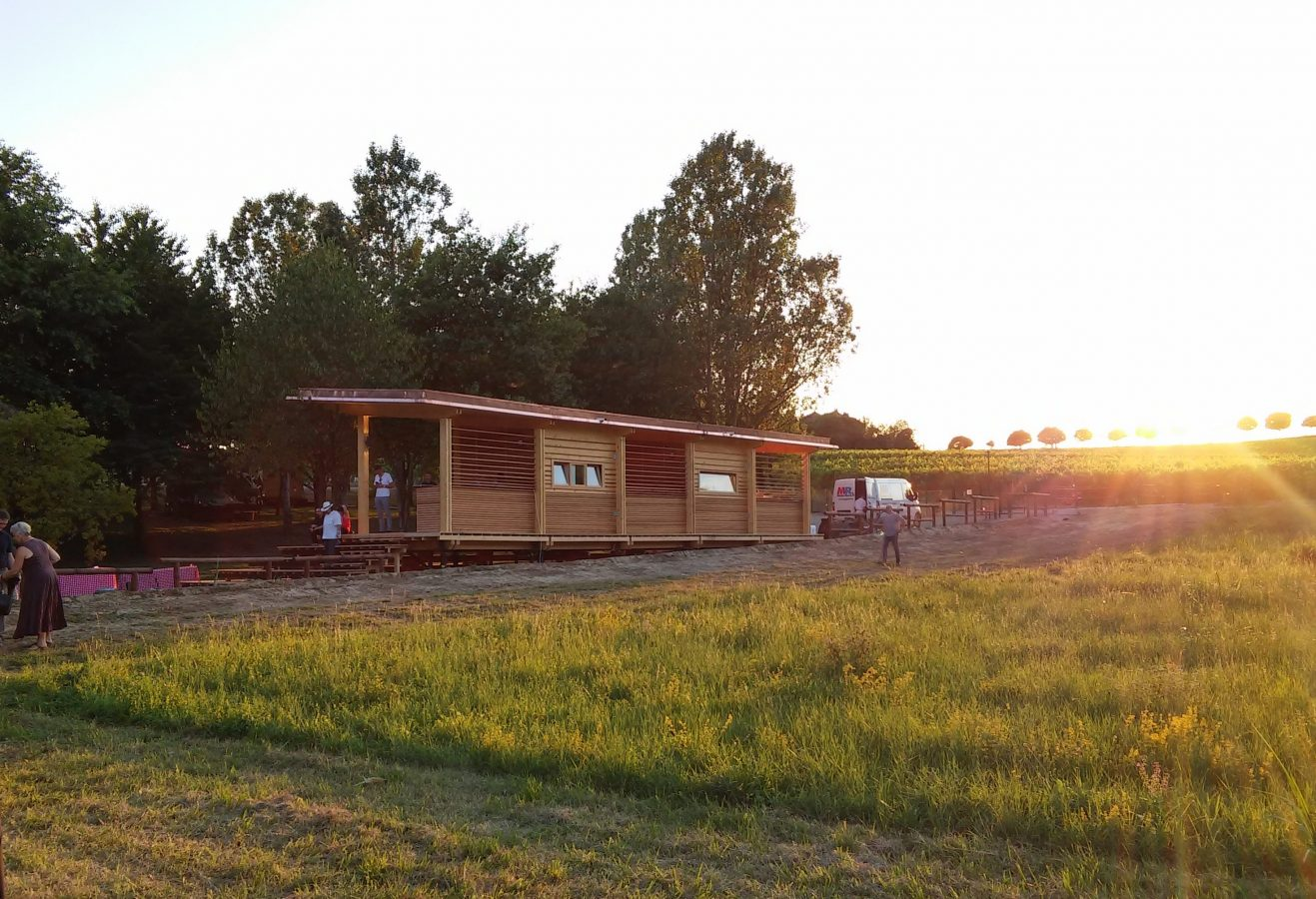 Orsolina28 glamping clubhouse at sunset