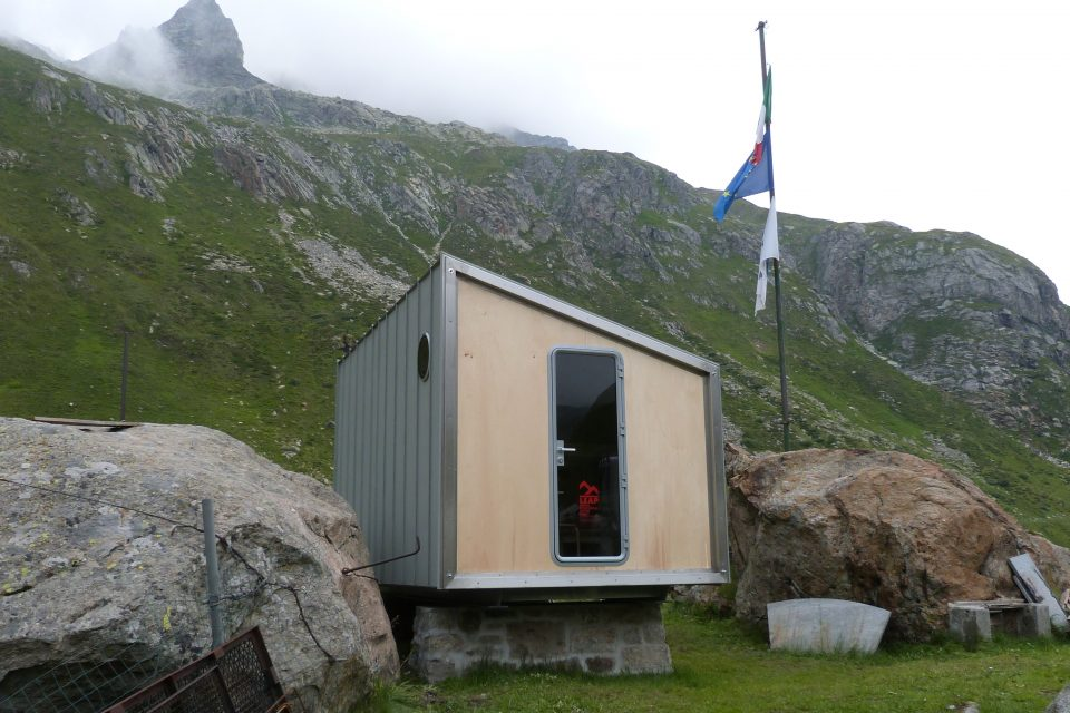 Margaroli Hut front view with flags
